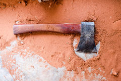 The axe on the sawdust. The axe on the sawdust background Royalty Free Stock Images