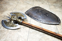 Axe with shield. Warriors equipment - Weapons used in war stock images