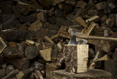An axe sticking in a chunk of firewood Stock Photos
