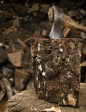 Axe sticking in a chunk of firewood Stock Photos