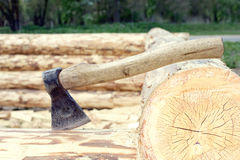 Axe stuck in a log closeup Stock Image