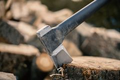 An axe stuck in a piece of wood on fresh air royalty free stock photos