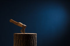 axe stuck in the wooden Stock Photography