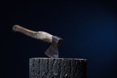 Axe stuck in the wooden Royalty Free Stock Photos