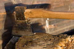 Axe stuck in a wooden stump Stock Photography