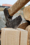 Axe in the stump Stock Photography