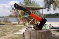 Axe in the stump Royalty Free Stock Image