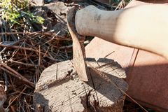 Axe in stump. Axe ready for cutting timber.Woodworking tool stock image