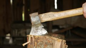Axe in a stump, close up. Old and rusty axe hit in the stump stock video
