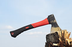 Axe in a stump. In the tourist camp on the background of blue sky, copyspace Stock Photography