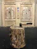 BURY THE HATCHET. Axe throwing. Axe throwing idea for the party. Place located in New Jersey, Bloomfield, Montclair stock images