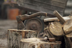 Axe thrusted in stump Stock Images