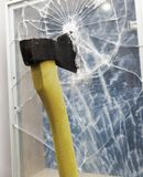 Axe to smash the window Stock Photo