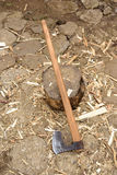 Axe used for splitting wood log Stock Photo