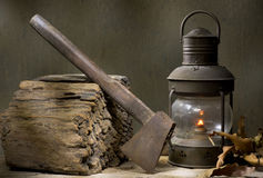 Axe With Lighted Lantern Stock Photo