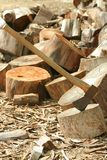 Axe and wood. Axe and piles of wood royalty free stock image