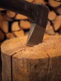 Axe in wood close-up Stock Photos