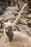 Axe and wood pile Royalty Free Stock Photos