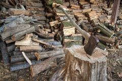 Axe and wood pile Stock Photo