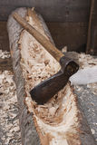 An axe and wood Stock Image