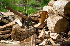 Axe and wooden log pieces Stock Photo