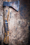 Axe on wooden plank Royalty Free Stock Photography