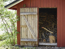 Axe and woodpile Royalty Free Stock Photos