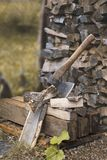 Axe and woodpile. Vertical image stock images