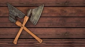 Axes ax knife crossed butcher craftmanship meat. Crossed axes in front of rustic wood floor royalty free stock photography