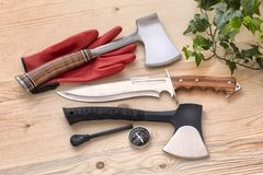 Knife, axes for adventure, explore, wilderness  compass and fire starter, survival tools for adventure, camping and outdoor life. Axes and knife for many works Royalty Free Stock Photography