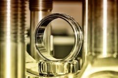 Axes métalliques d'anneau et en métal Brown a modifié la tonalité photographie stock libre de droits