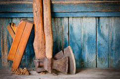 Axes, planer shavings, chips on the old blue wooden background.  Royalty Free Stock Images