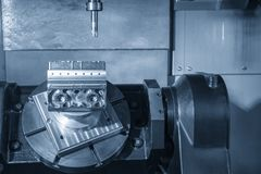 The  5-axis CNC machining center  cutting the automotive part . The hi technology manufacturing process of automotive parts royalty free stock photos