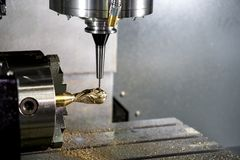 The 4-axis CNC milling machine . The 4-axis CNC milling machine or machining center attach the rotation axis cutting the sample part with the solid ball endmill stock image