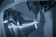 The 5-axis CNC milling machine cutting the aluminium turbine part. The hi-precision CNC milling machine stock images