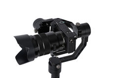 Stabilization System with 3-axis gimbals & Mirrorless Camera. 3-axis gimbals Stabilization System with Mirrorless Camera. Using this equipment, a Videographer Royalty Free Stock Photo