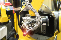 6 axis robot arm with sensor working with High precision CNC las Stock Photo