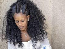 Ethiopian woman with artistically created hairstyle, April 27th. 2019,Axum, Ethiopia royalty free stock image