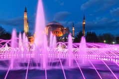 Aya Sofia Mosque with fountain at sunset. Aya Sofia Mosque at sunset seen from the near park royalty free stock images