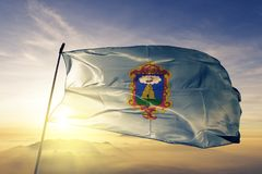 Ayacucho Region of Peru flag textile cloth fabric waving on the top sunrise mist fog. Beautiful royalty free stock image