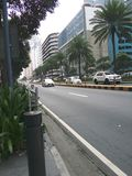 Makati City street. Ayala avenue in Makati City, Philippines without the traffic. It was a weekend when I shot this so there aren`t that much vehicles royalty free stock photo