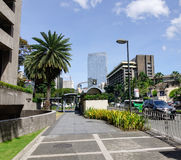 Ayala avenue with palm trees at the Manila city in Philippines Royalty Free Stock Photos