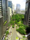 Ayala triangle in ayala, makati city, philippines. Aerial view of ayala triangle along ayala avenue in makati city in philippines, asia stock photos