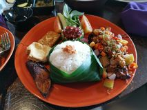 Ayam bakar in Bali restaurant. Food, lunch, meal, rice, dish, chilli, chicken stock image