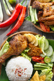 Ayam Penyet rice. Popular Indonesian local food nasi ayam penyet, indonesian fried chicken rice. Fresh hot with steam smoke stock images
