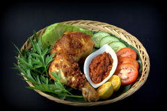 Ayam Penyet. A set of 'Ayam Penyet'. Ayam penyet is Indonesian cuisine. fried chicken dish consisting of fried chicken , served with sambal, slices of cucumbers stock images