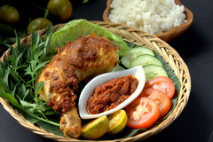Ayam Penyet. A set of 'Ayam Penyet'. Ayam penyet is Indonesian cuisine. fried chicken dish consisting of fried chicken , served with sambal, slices of cucumbers royalty free stock photography
