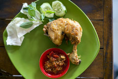 Ayam Penyet (smashed fried chicken), a common Javanese food found at street of Indonesia. Royalty Free Stock Images