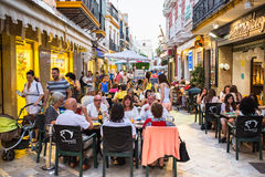 Ayamonte, Andalucia, Spain. AYAMONTE, SPAIN - JULY 3 2015 Tourists and locals enjoy alfresco dining during La Noche en Blanco, a promotional evening for Ayamonte stock photos