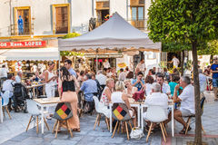 Ayamonte, Andalucia, Spain. AYAMONTE, SPAIN - JULY 3 2015 Tourists and locals enjoy alfresco dining during La Noche en Blanco, a promotional evening for Ayamonte royalty free stock photo